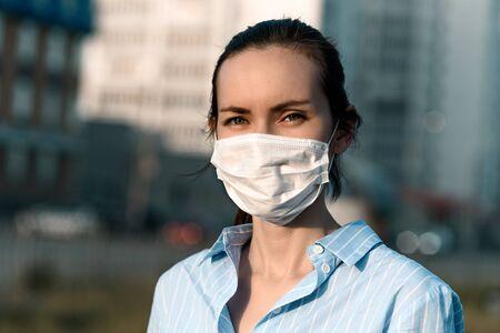 caucasian brunette woman in medical mask in street, coronavirus, Allergy concept, safety