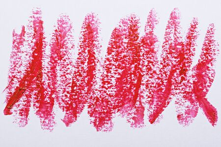 art strokes of scarlet red lipstick on white background, cosmetic smears Banque d'images