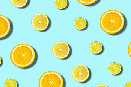 citrus on blue background, oranges, limes slices, top view, flat lay
