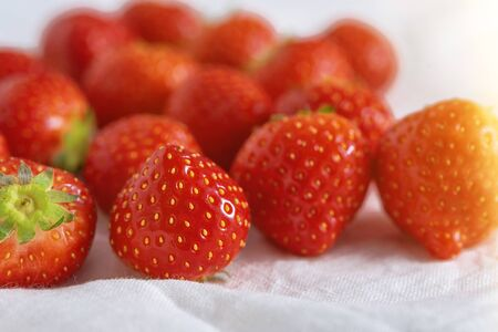 closeup strawberries on white background, summertime concept
