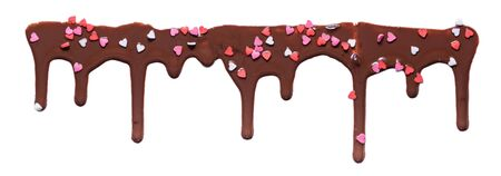 chocolate melted icing with heart pastry sprinkles on white background for banner, art texture with copy space Banque d'images