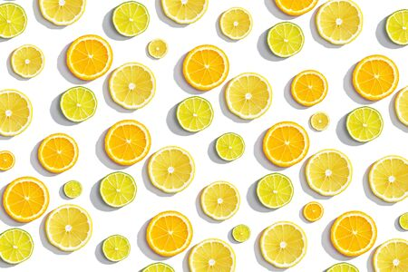slices oranges, lime on white background, summer citrus background, top view, flat lay