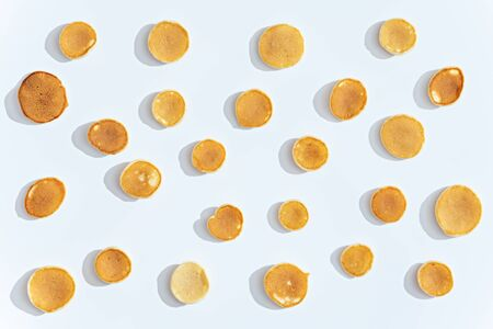 trendy tiny cereal pancakes pattern on white background, top view