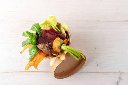 top view compost concept, vegetable peels in cardboard biodegradable container on white background, copy space Stock Photo