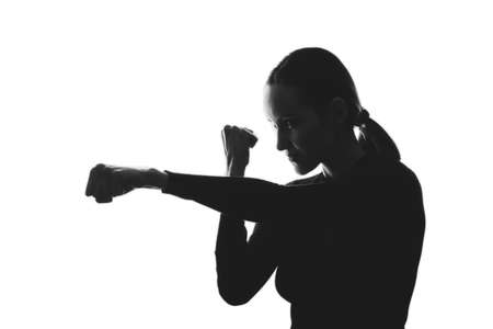 trendy black and white silhouette portrait of woman, strike, defense concept