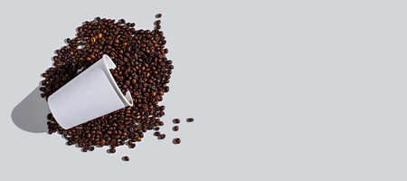 white paper disposable Cup with scattered coffee beans on white background, copy space, banner, top view