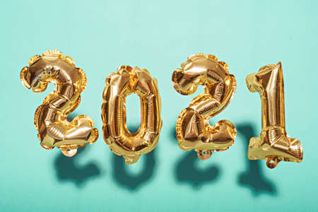gold foil balloons numbers 2021 on blue background with shadow, new year's composition Archivio Fotografico