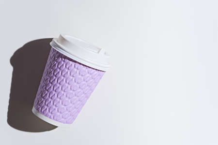 purple paper disposable cup on white background with shadow, copy space, top view, mock up