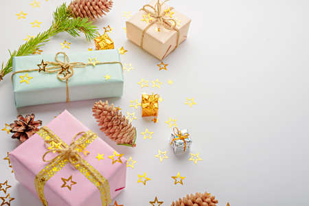 pastel boxes with glitter stars, cones on white background, Christmas gifts concept, copy space Archivio Fotografico