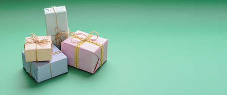 pastel gift boxes on green background, me-gift, copy space, banner