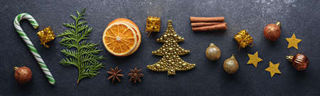 Christmas composition on gray background, candy, Christmas toys, balloons, stars, dried orange, top view, menu, festive kitchen background for banner, Archivio Fotografico