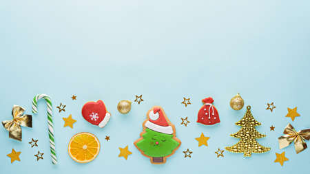 Christmas composition on blue background, top view, menu, festive kitchen background, copy space