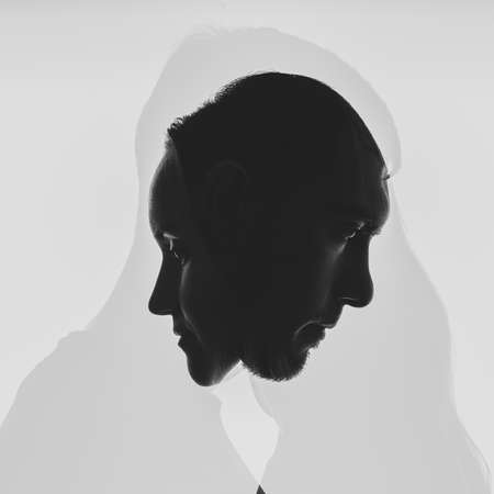 multi exposure black and white silhouettes of portraits men and women on white background. relationships between men and women concept, family