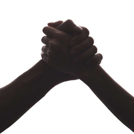 black and white silhouette of hands on white background, handshake, friendship concept