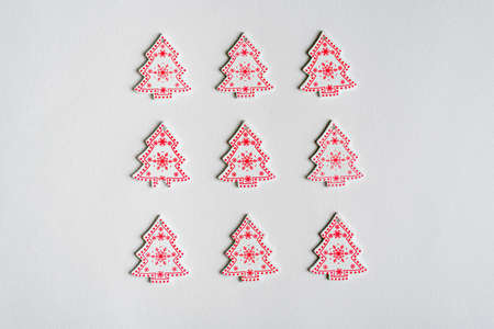 many wooden Christmas trees with decor on white background, Christmas composition, top view