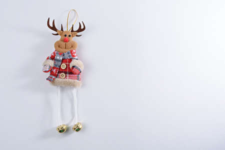 Christmas toy deer on white background, Christmas stuffed toys, copy space, top view