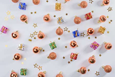 new year, Christmas background, Christmas balls toys, gift boxes with sequins on white background, top view