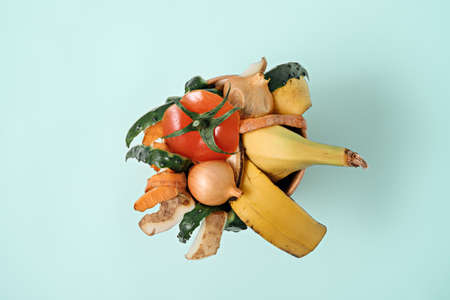 top view vegetable peeling on blue background, composting, Sustainable and zero waste