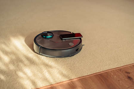 Robotic floor scrubber, Robotic vacuum cleaner on carpet and laminate, smart cleaning concept