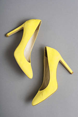 Yellow high heels shoes, isolated on white Фото со стока