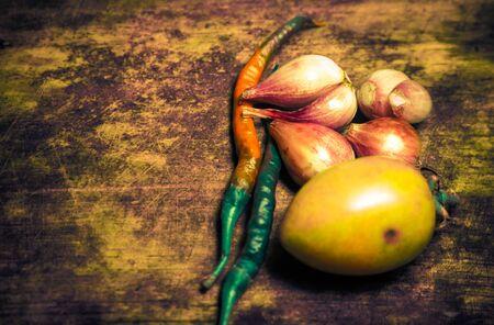 Various vegetables on wooden bacgkround Imagens