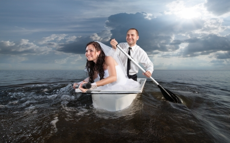 wife of bath: Bride and groom are floating on the sea