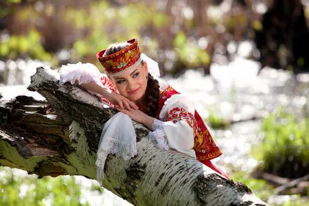 national: Beautiful girl in a russian national dress outdoors