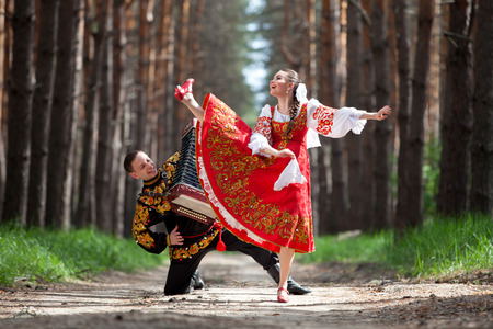 folk festival: Couple of dancers in russian traditional costumes Stock Photo