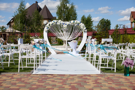 Arch and chairs at wedding ceremony outdoor
