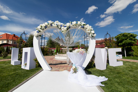 wedding chairs: Arch at wedding ceremony outdoor Stock Photo
