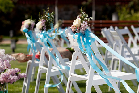 Wedding ceremony chairs and a bouquet of roses