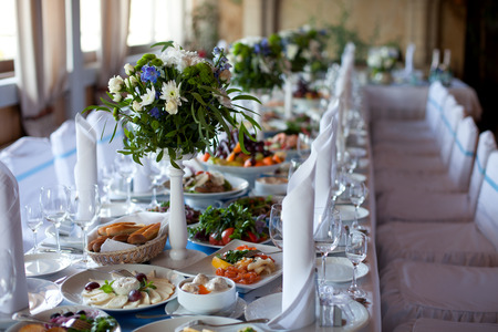 banquet table: Served for a banquet table. Wine glasses with napkins, glasses and salads. Stock Photo
