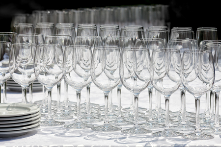 wine glasses: Wine glasses with plates on the table. Black background