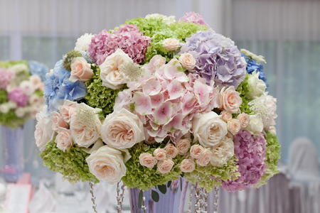 Flowers in a vase for the wedding ceremony. Beautiful decoration