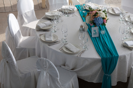 restaurant dining: Elegance table set up for wedding in turquoise top view
