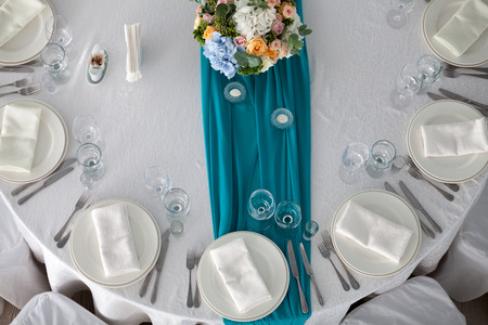 table set: Elegance table set up for wedding in turquoise top view
