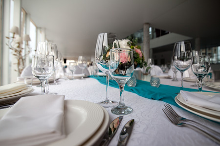 restaurant interior: Elegance table set up for wedding in turquoise