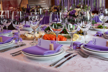 celebration event: Salads and empty wine glasses set in restaurant