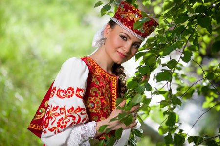 Beautiful Russian woman in national clothes Stock Photo