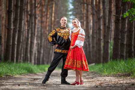 Man and woman in Russian national clothes Фото со стока