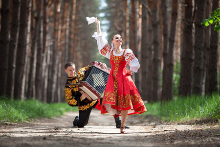 Man and woman in Russian national clothes 스톡 콘텐츠