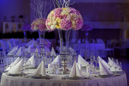 elegant party: Table setting at a luxury wedding reception. Beautiful flowers on the table.