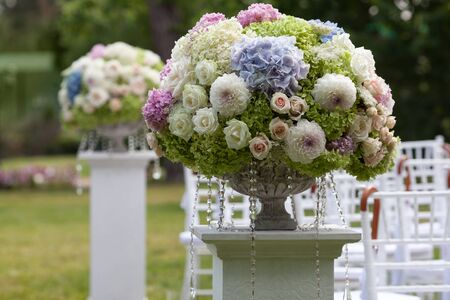 arrangements: Beautiful wedding set up. Flowers in a vase for the wedding ceremony Stock Photo