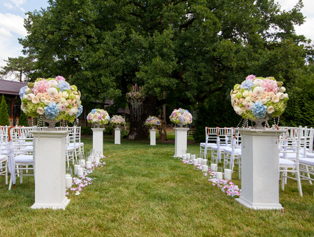 set up: Beautiful wedding set up. Flowers in a vase for the wedding ceremony Stock Photo