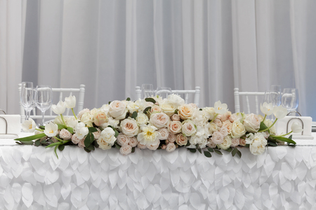 reception: Table setting at a luxury wedding reception. Beautiful flowers on the table.