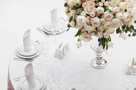 table decoration: Table setting at a luxury wedding reception. Beautiful flowers on the table.