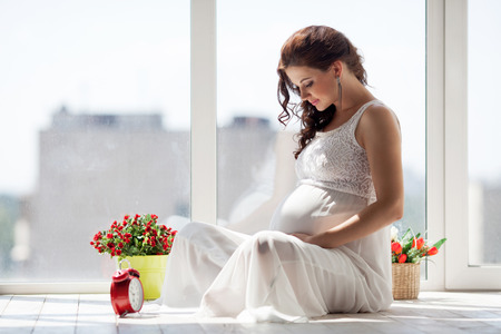 woman happy: Happy pregnant young woman waiting for a child Stock Photo