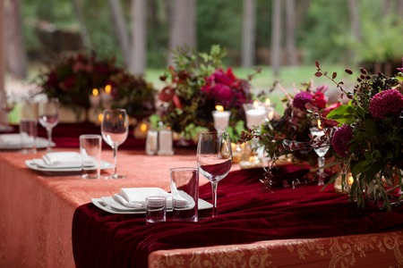romantic places: Table setting at a luxury wedding reception. Beautiful flowers on the table.