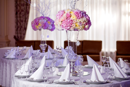 table setting: Table setting at a luxury wedding reception. Beautiful flowers on the table.