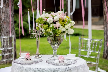 Table set for an event party or wedding reception. Beautiful flowers on the table.